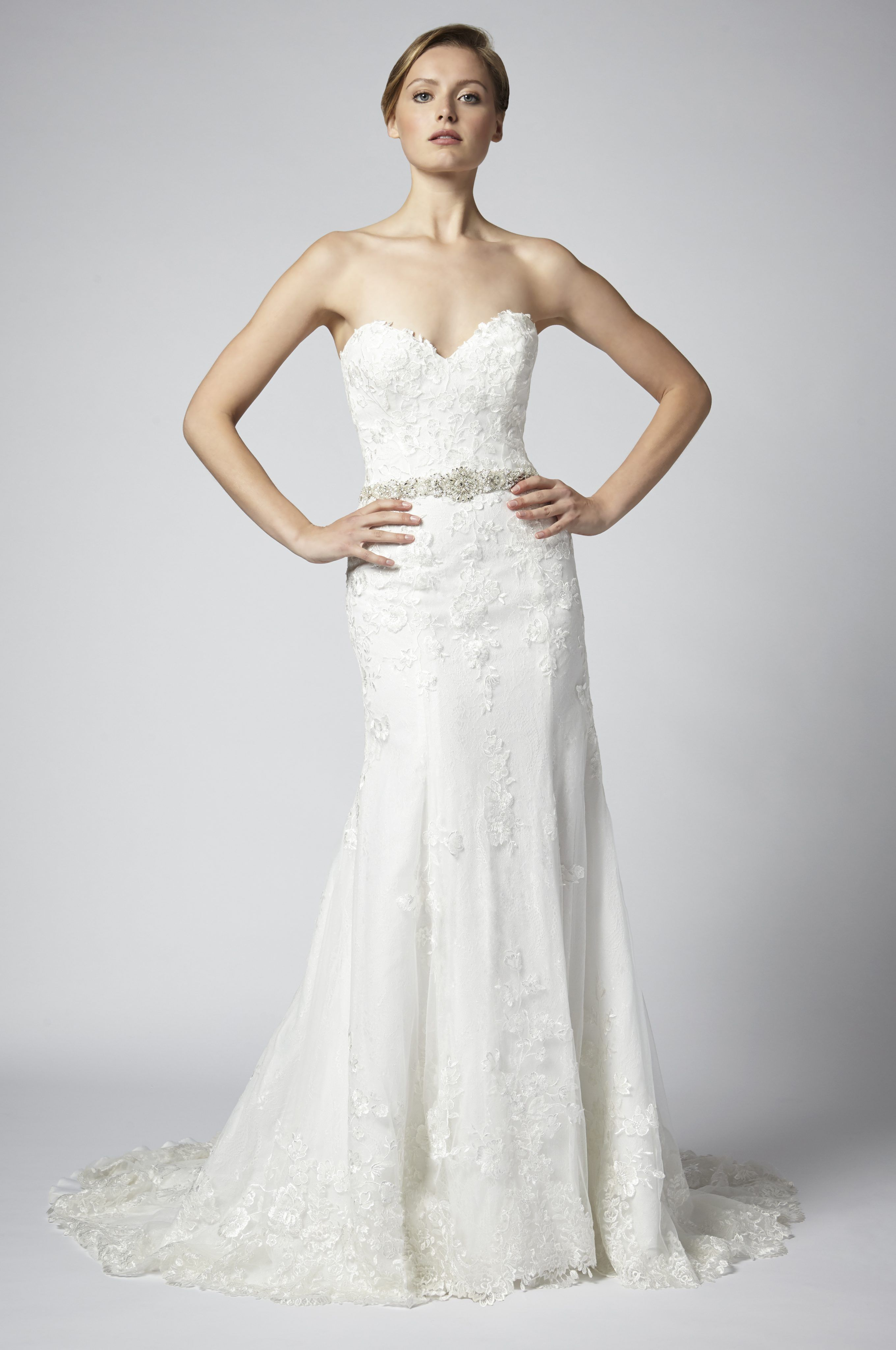 Fit and flare lace strapless wedding dress with beaded