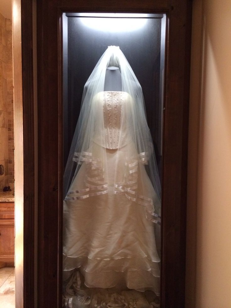My clients wedding dress! A built in shadow box with her wedding gown hung in the hallway that connects her bathroom to her huge walk in closet! Omg I love the