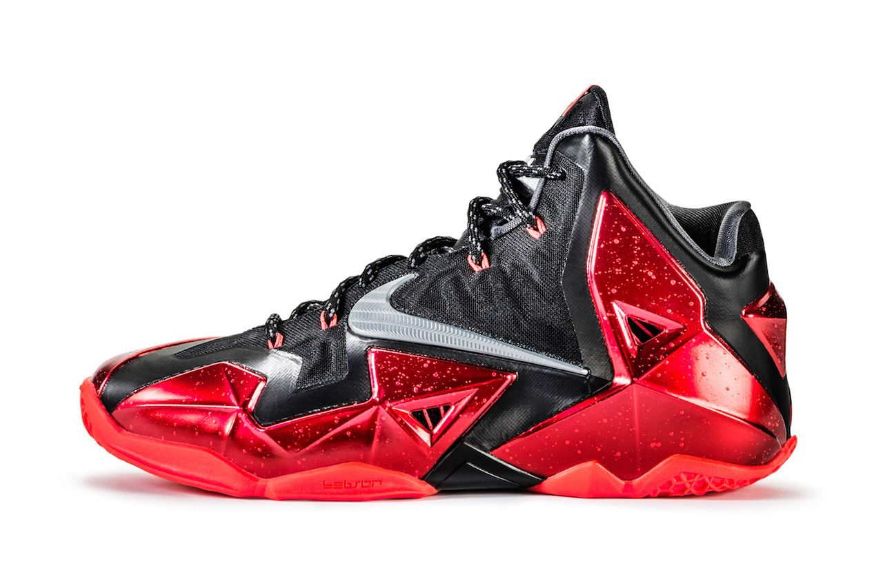 "We present a detailed look at the Nike LeBron 11 in a black and red ""away""  colorway. The shoe's technical benefits bolster LeBron James' ability to  sprint,"