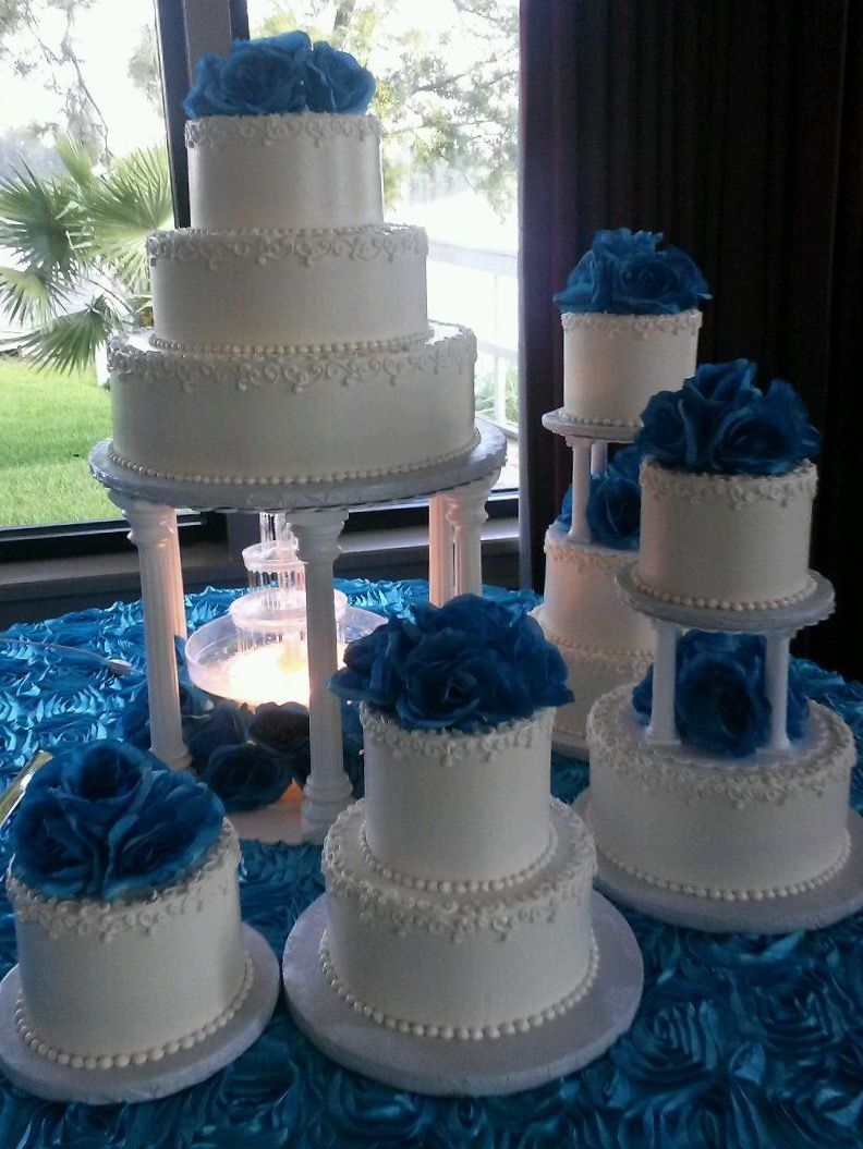 11 Tier Quinceanera Cake With Buttercream Icing And Blue Flowers Cake Has Columns And Water Fountain Fountain Cake Quinceanera Cakes Cake