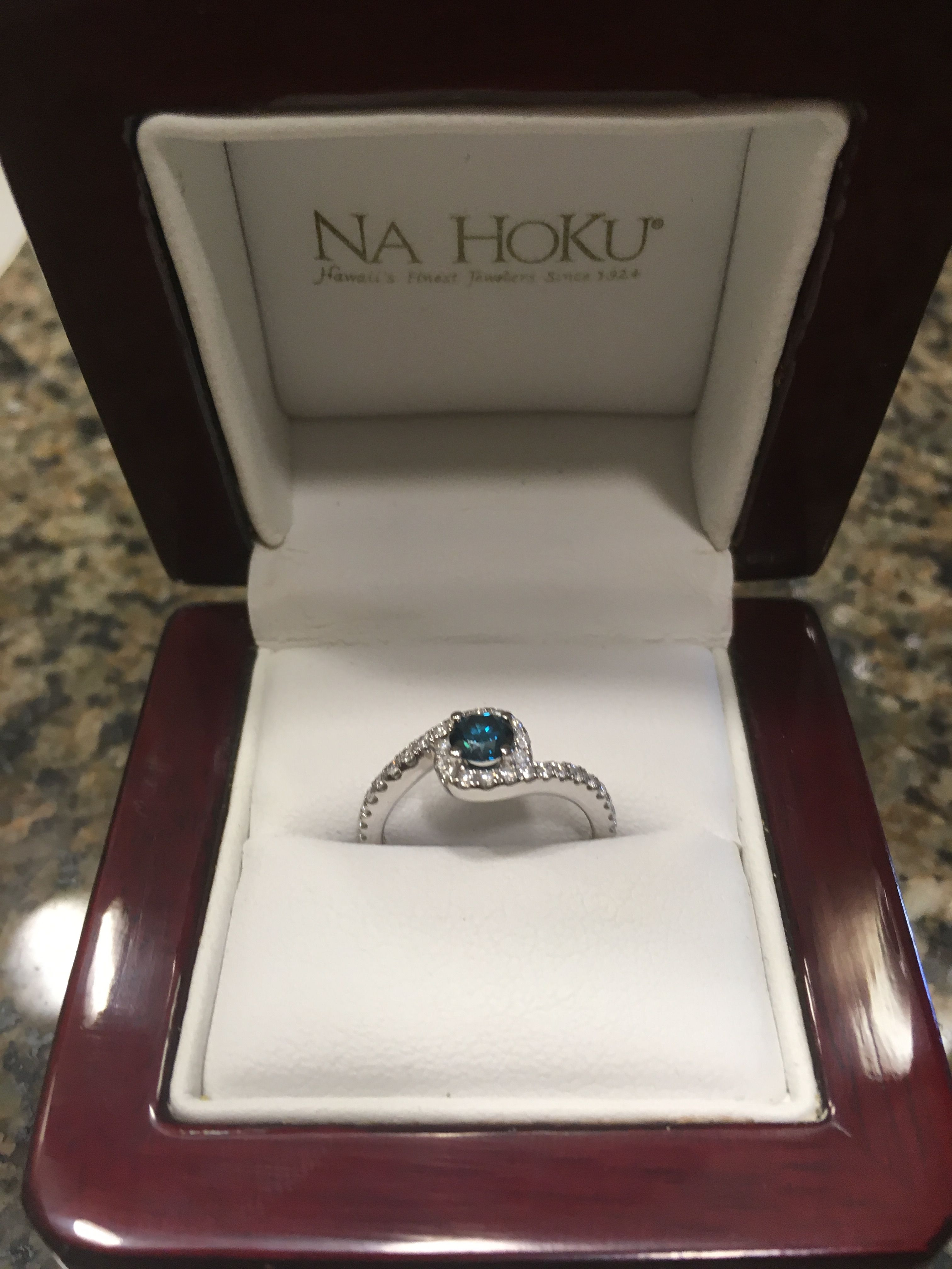 My engagement ring blue diamond center ring looks like waves from