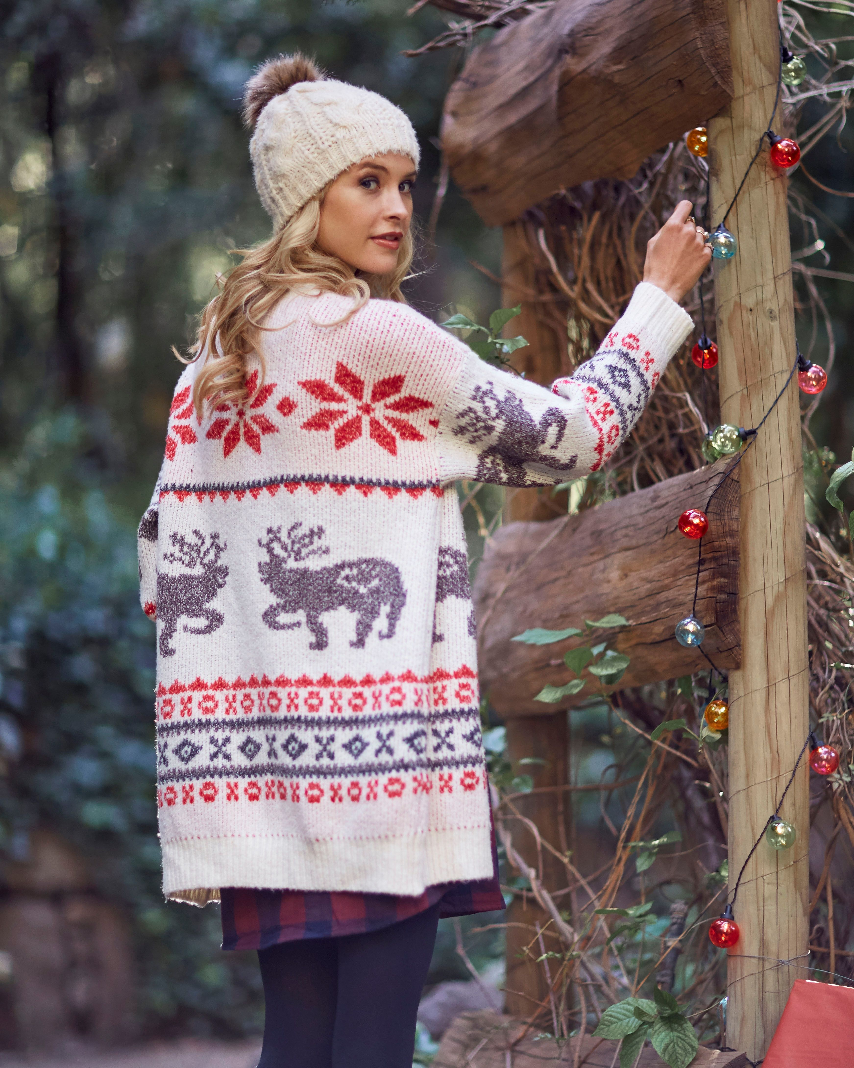 07d910a355a87 Bundle up for the festive season ahead! Our Reindeer Cardigan Sweater is  perfect for decorating the house and Christmas morning.