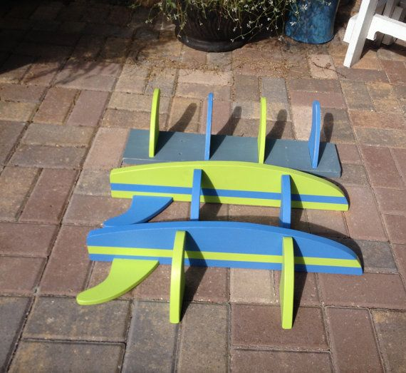 3 Item Set:  24 wood painted and distressed board with 4 surf fins also cut from wood and painted blue and green, on grey back board. For hanging