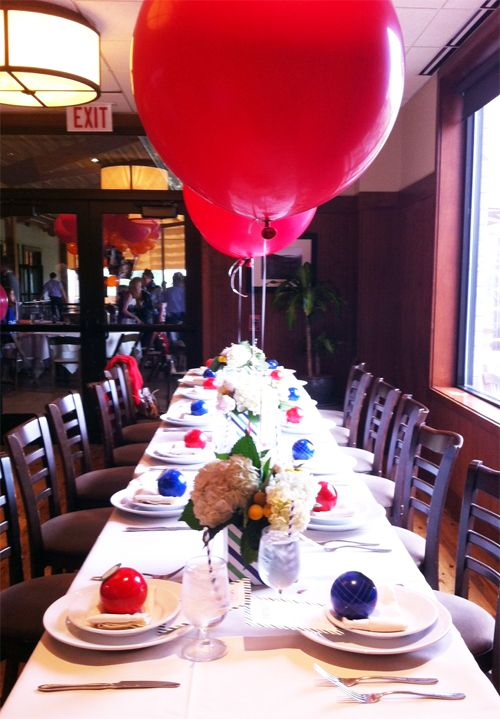 Bocce Birthday Dinner-One long table, three striped centerpieces of big  white