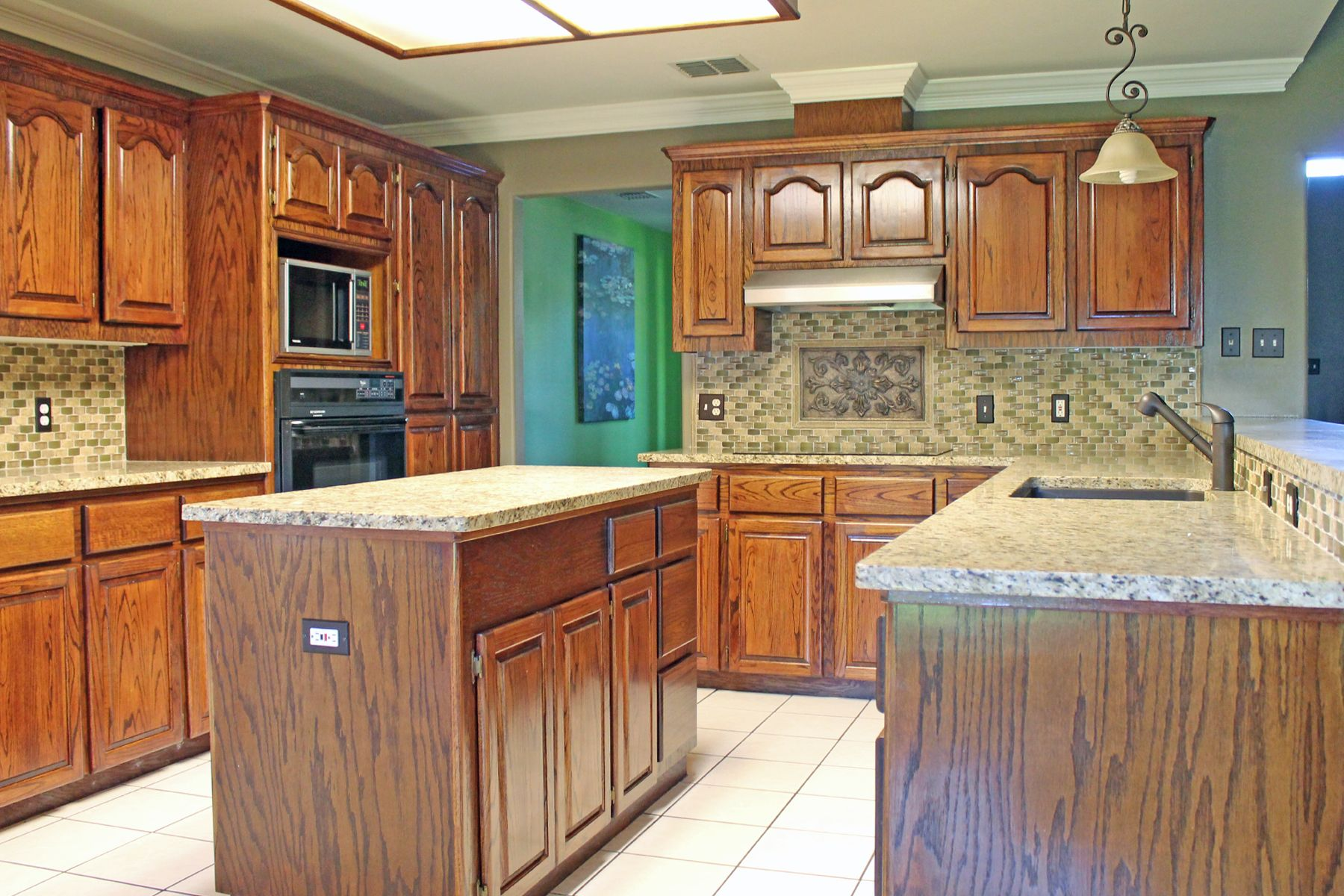 #Kitchen Design With Light Granite Countertops And Mosaic Tile Backsplash.  #ideas
