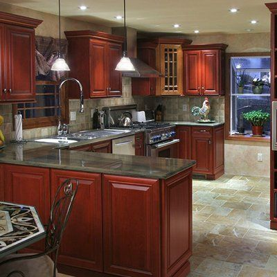 Black Granite with Cherry Cabinets Kitchen