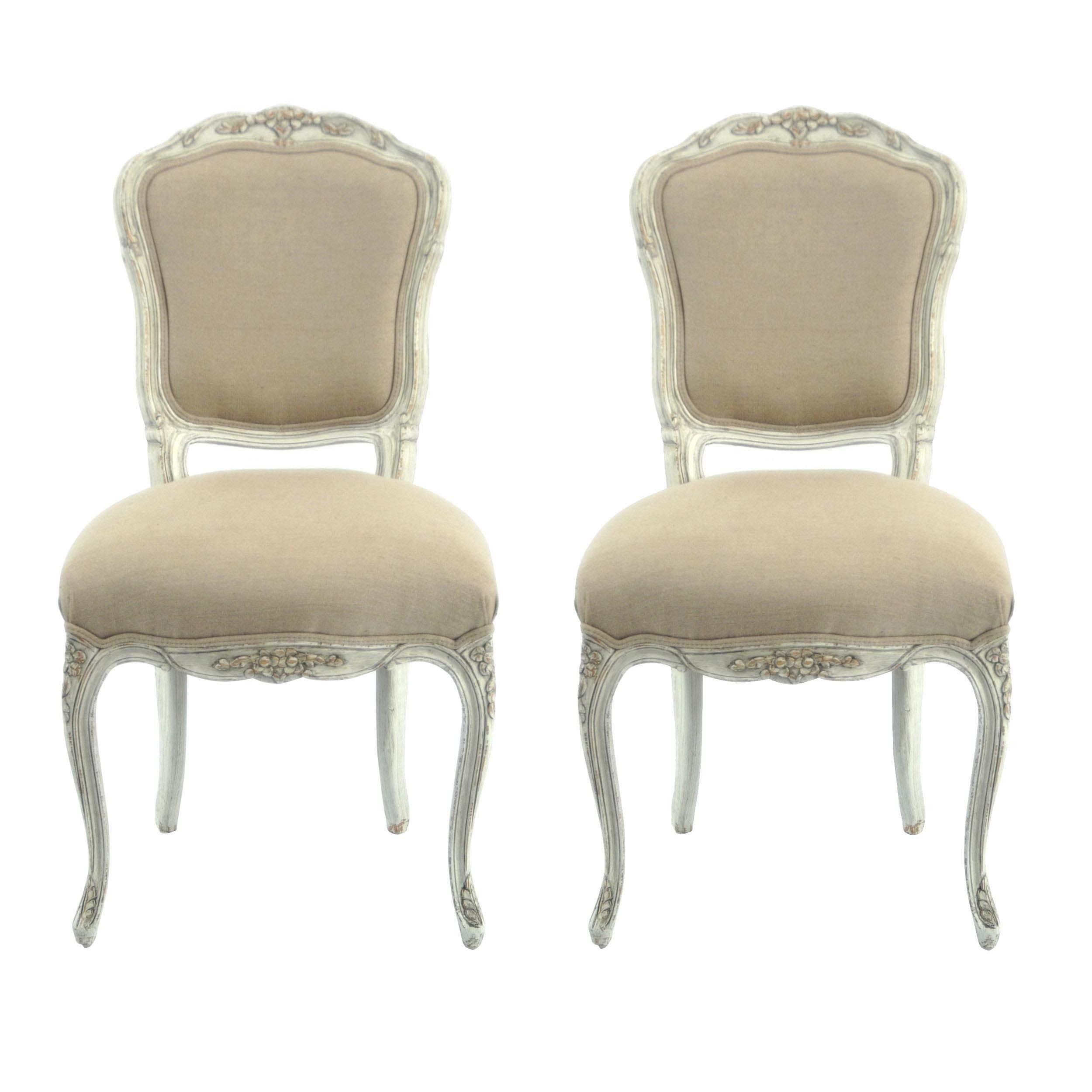 Give your home a European flair with this set of two antiqued French side chairs. Finished in distressed white with cotton/linen-blend ivory upholstery, the hand-carved chairs add just the right touch to any formal living room or master bedroom.