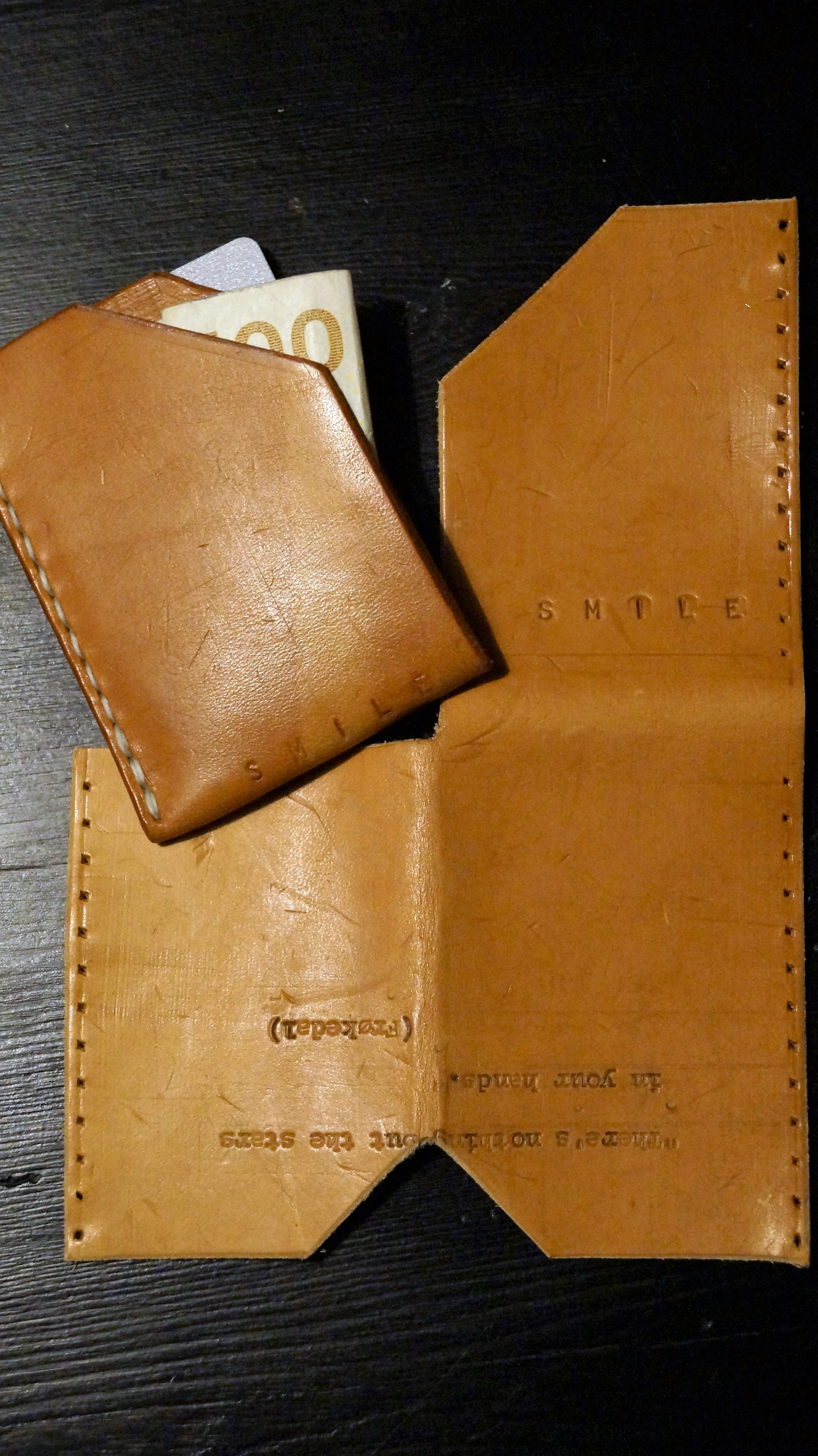 Card holder. One piece leather. Stamped and written on with an old ...