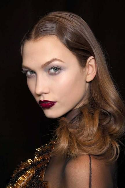 pairing a grey smokey eye with glossy burgundy lips.