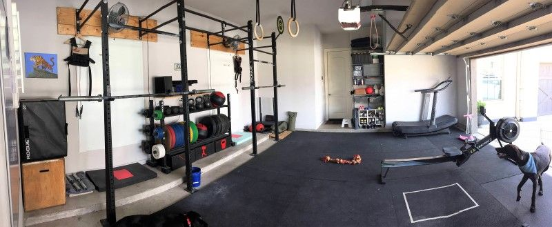Benjamins garage gym for him and his wife. two station rig cardio
