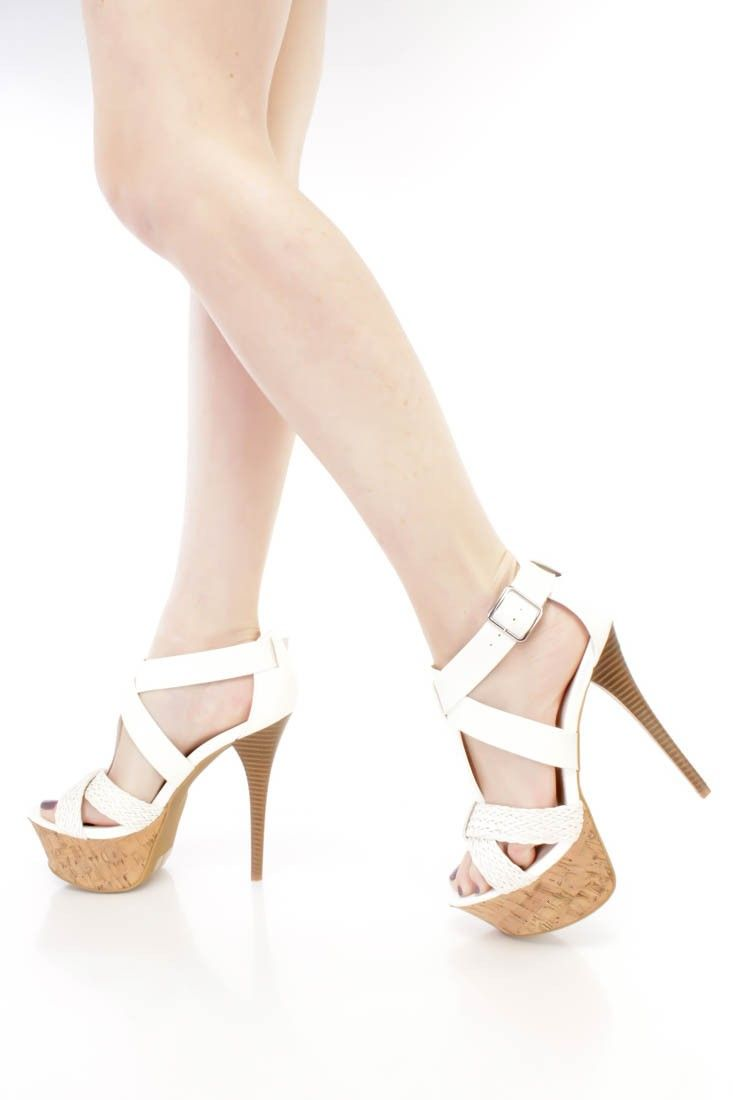These sexy and stylish platform stiletto high heels are a must have this season! The features include a faux leather upper with an open toe, strappy design, woven cross strap vamp, side buckle closure, faux wooden stiletto heel, cork platform, smooth lining, and cushioned footbed. Approximately 5 3/4 inch heels and 2 1/4 inch platforms.