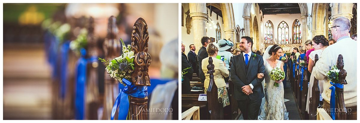 Bunches of flowers tied to the pews with blue ribbon at the church