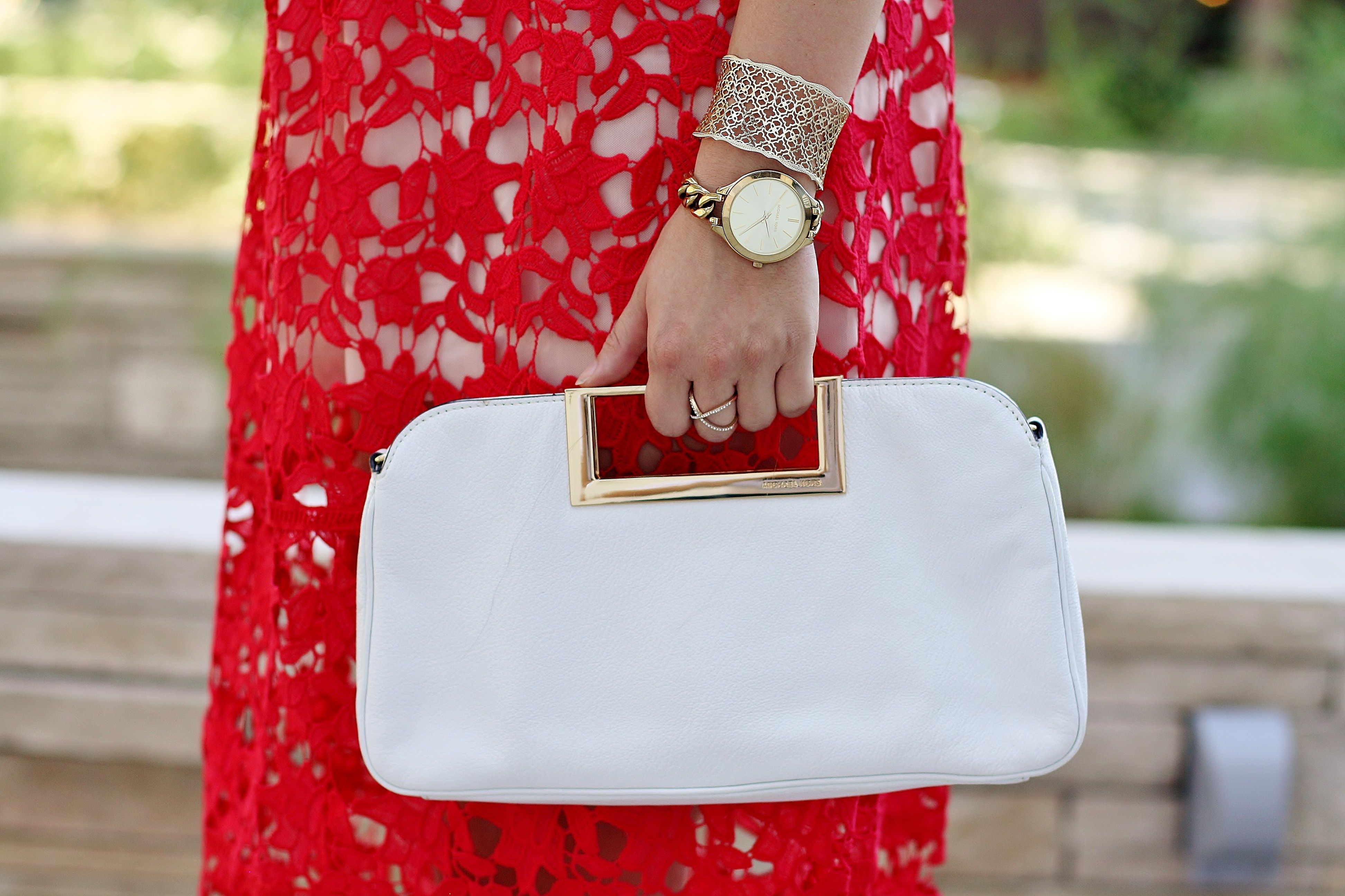 Holiday Prep Checklist & Timeline;  how to get ready for the holiday;s red holiday dress; Christmas dress; Christmas prep; white taseel earrings; white clutch; black rockstud pumps