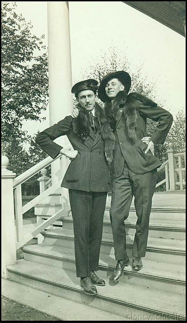 Two well dressed men complete with mink stoles. Details unknown.