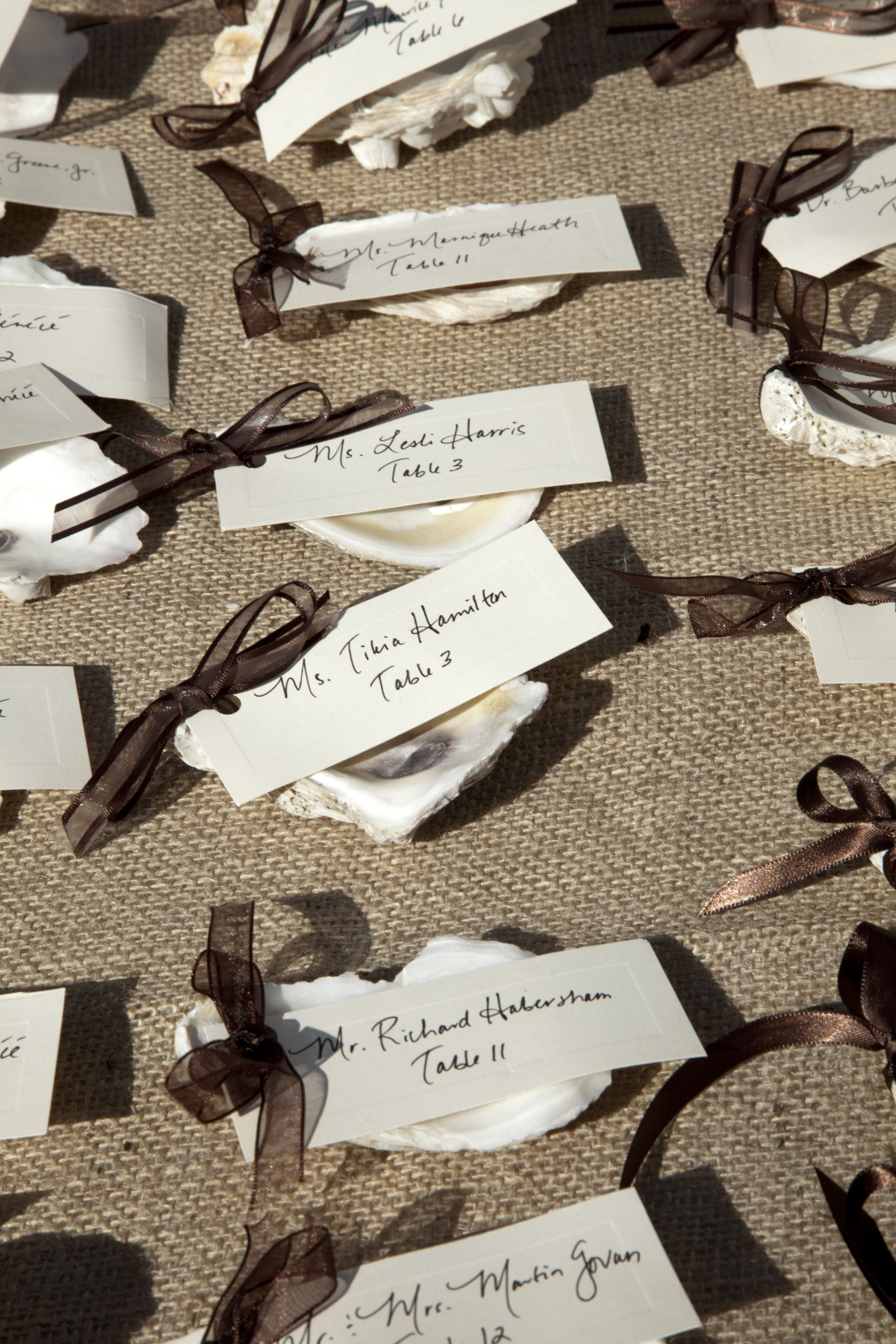 Oyster shells attached to place cards Simple