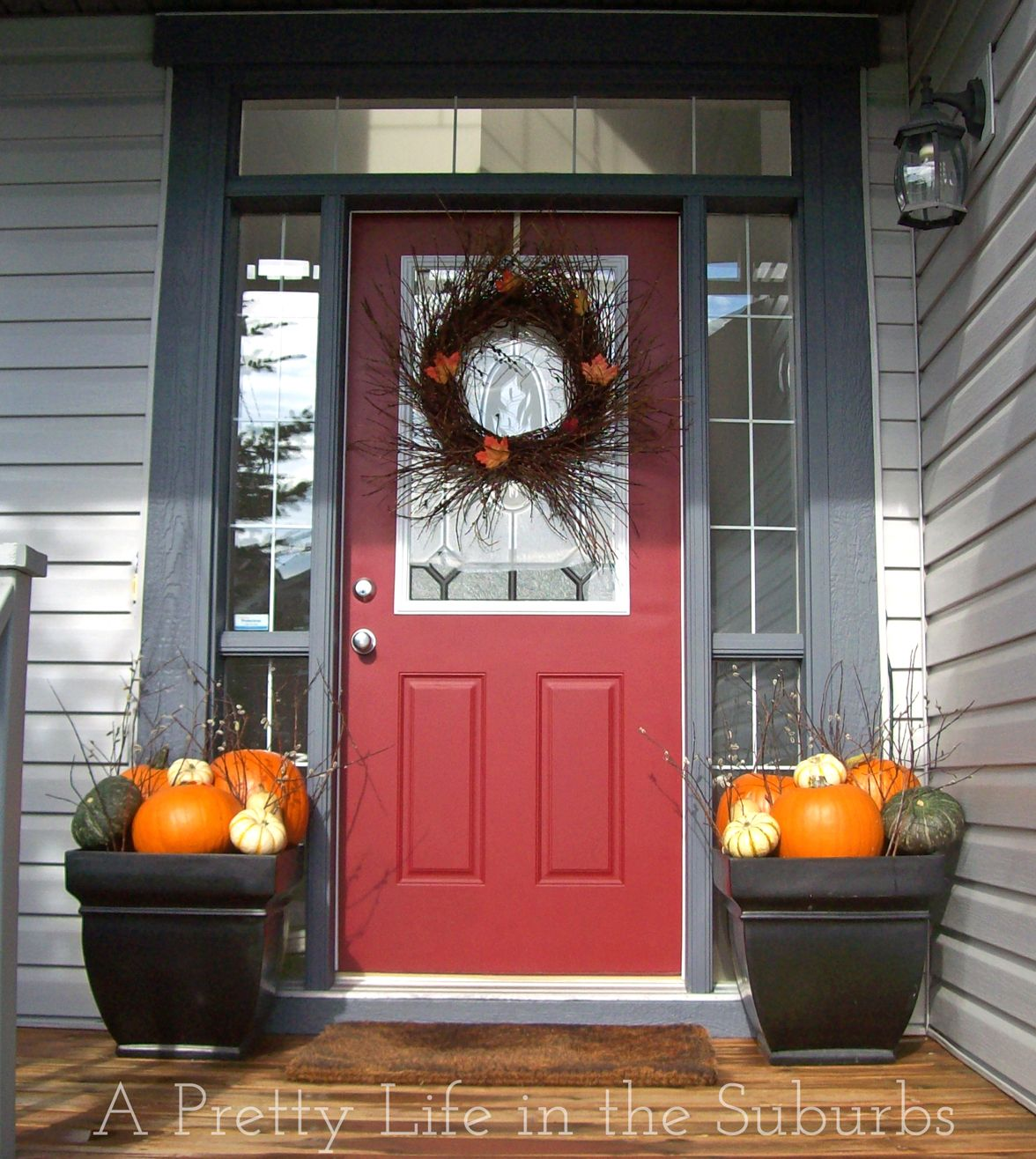Easy Pumpkins And Branches In Planters Fall Porch Decorating Ideas A Pretty Life