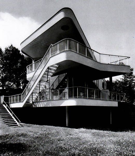 Villa Schminke by Hans Scharoun in Löbau, Saxony, Germany was built in 1933. Hans Scharoun was an exponent of organic and expressionist architecture and the house has a curved main body, terraces and outside stairs.