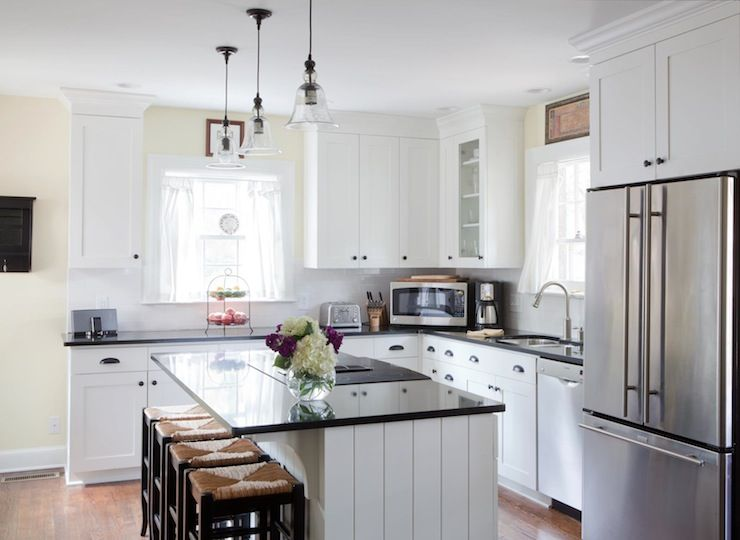 L shaped kitchen with crisp white shaker cabinets paired for Kitchen cabinets 8x10