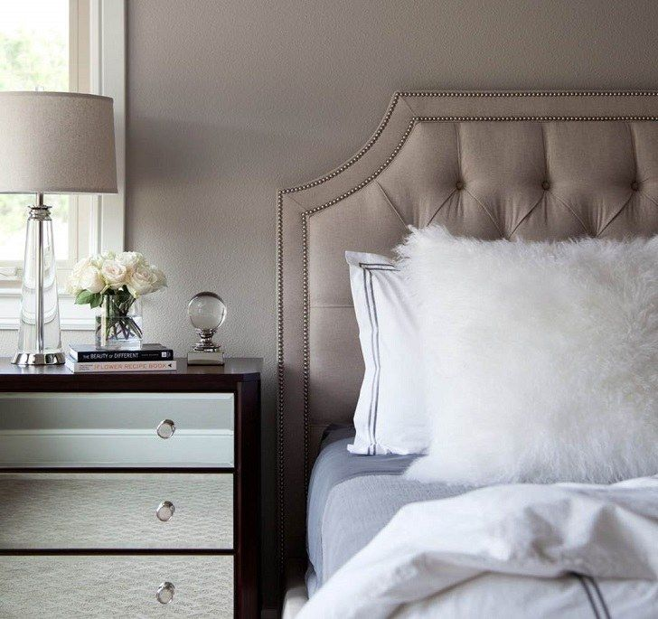 Taupe bedroom wall color and tufted bed