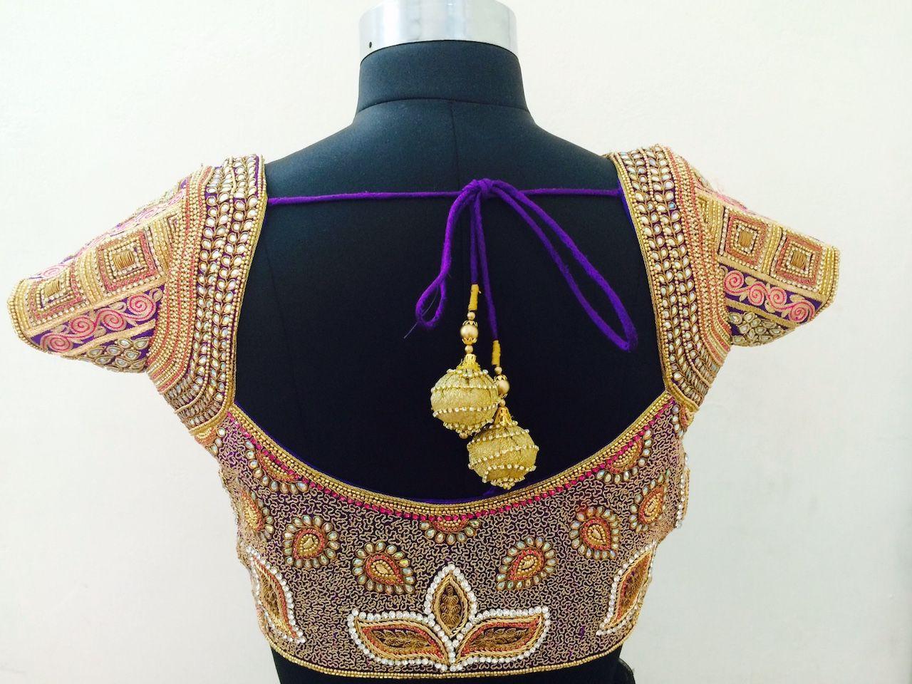 paroksha-deep cut neck bordered with embellishments