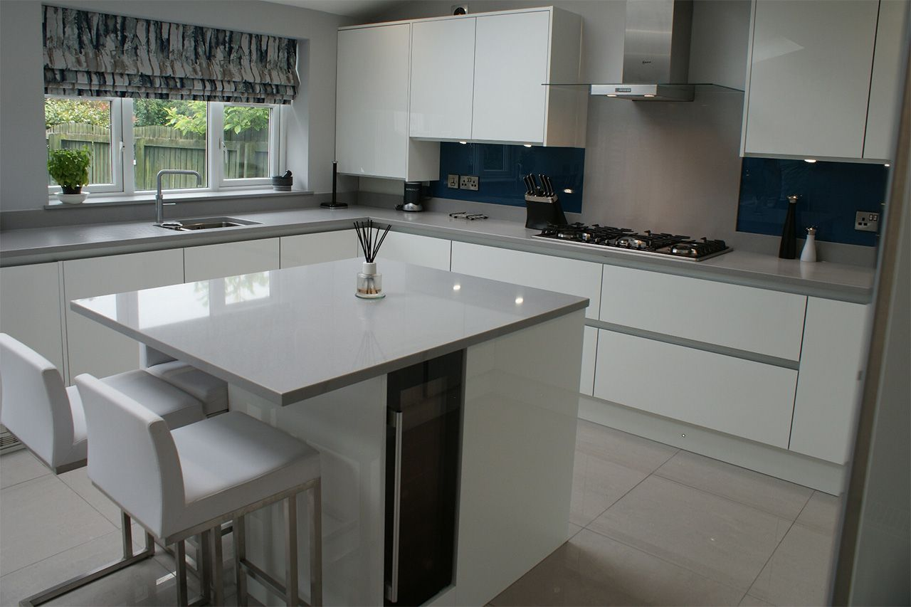 ultragloss-white-with-quartz-surfaces-porcelain-floor-glass-splashback-and-neff-appliances-with-a-quooker-tap3