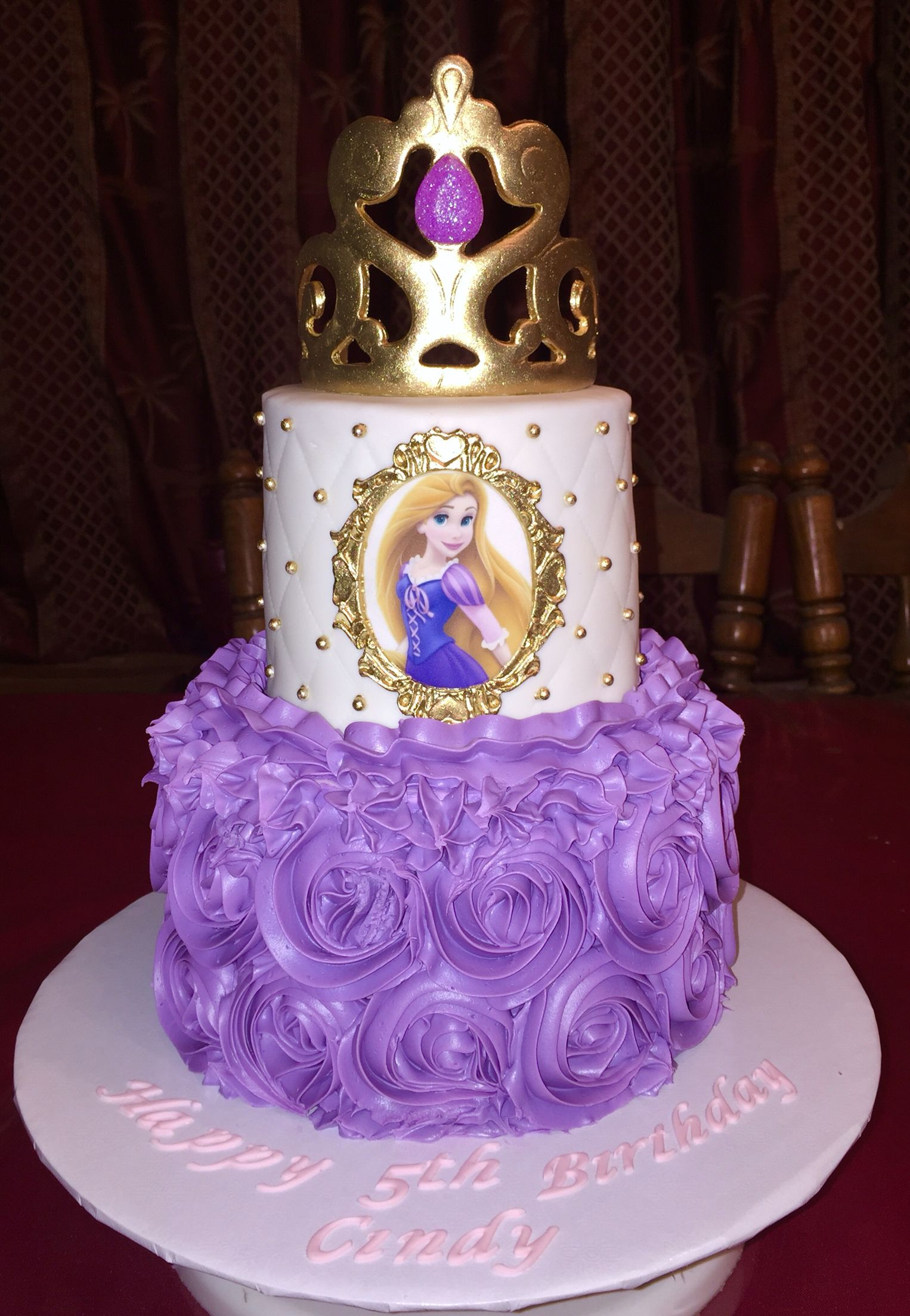 I made this 2 tier rosette repunzel cake with edible images and