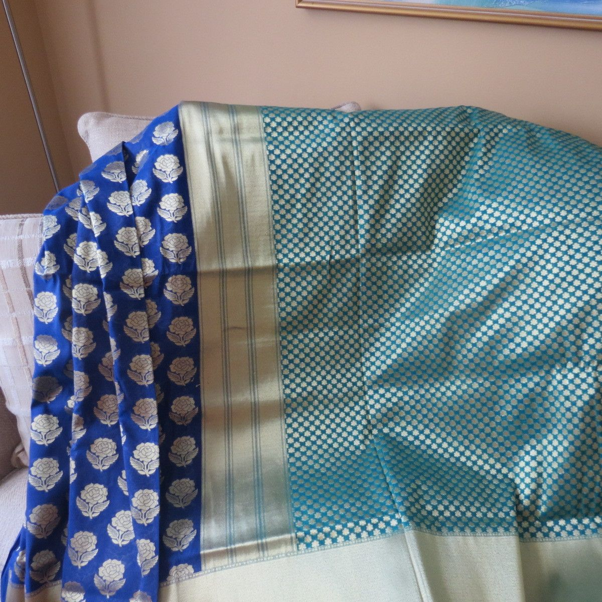 Look sensuous in this lustrous pastel blue Half and half Opara silk katan with all over hand woven zari butis. The majestic blue border and pallu have heavy gold zari weave. This bridal hue comes with silk blouse material.