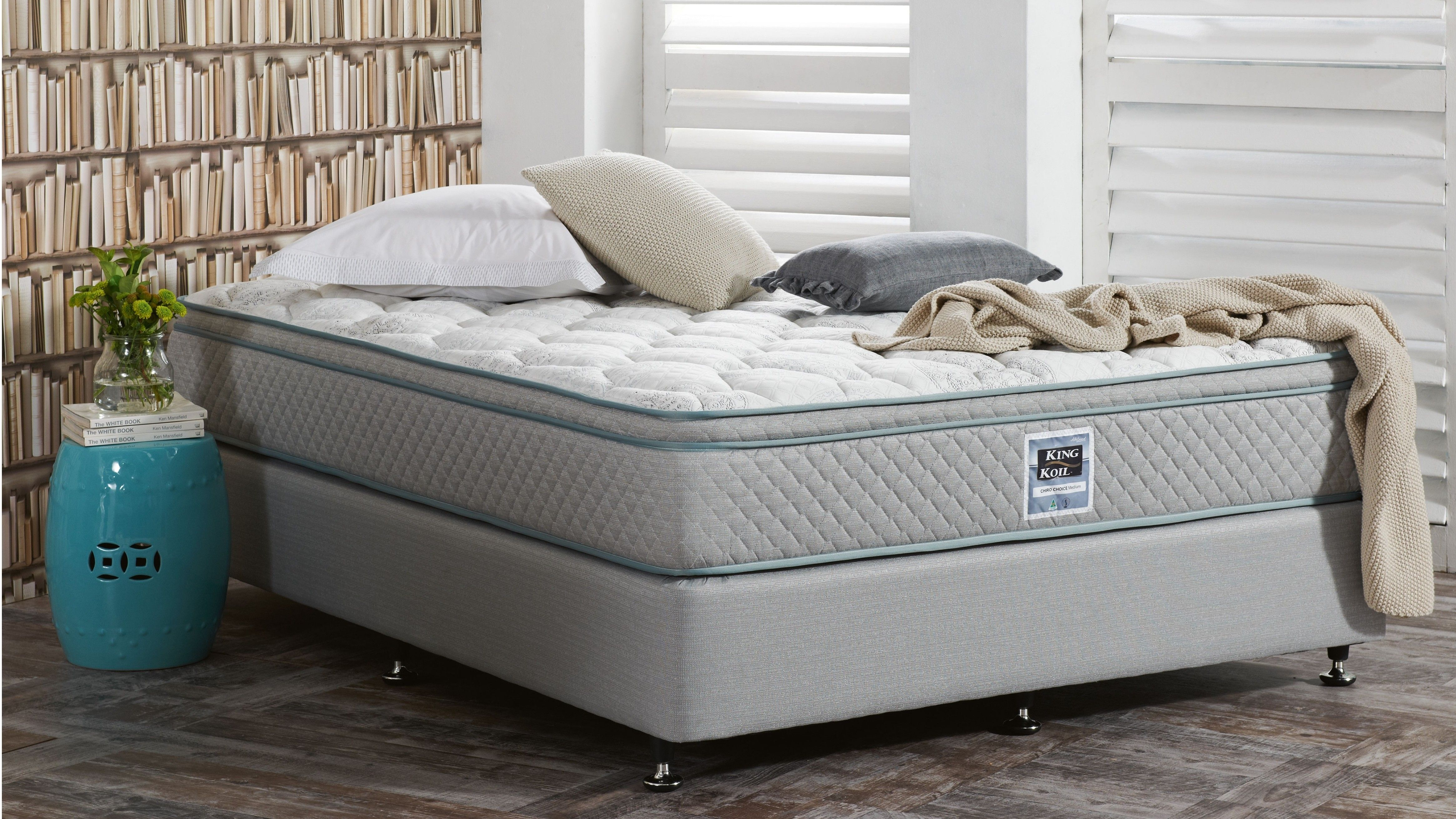 featuring contour coil support to promote correct sleep posture and