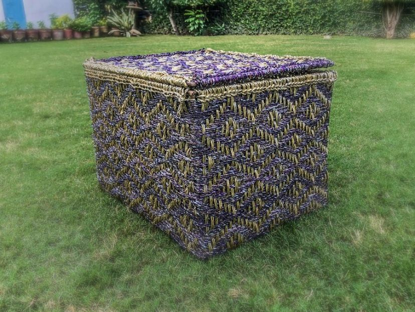 This box is made from wrappers of Cadbury's Dairy Milk, and so we have named it the Dare-y Milk Medium Storage Box. Also available in the 'Kurkure' version. #wastetowow #wovenfurniture #vintagefurniture #charpoy #charpai #weaversofinstagram #sustainableliving #sustainabledesign #circulareconomy #circularfurniture #supportyourladies #surviveandthrive #sustainableliving #sustainablefurniture #circularfurniture #skilledsamaritan #vocalforlocal #womenentrepreneurs #enretreneursofindia #womenindesign