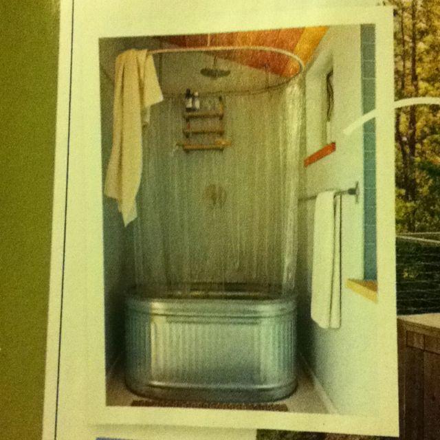 A feed tub used as a shower stall/soaking tub. I love this idea ...