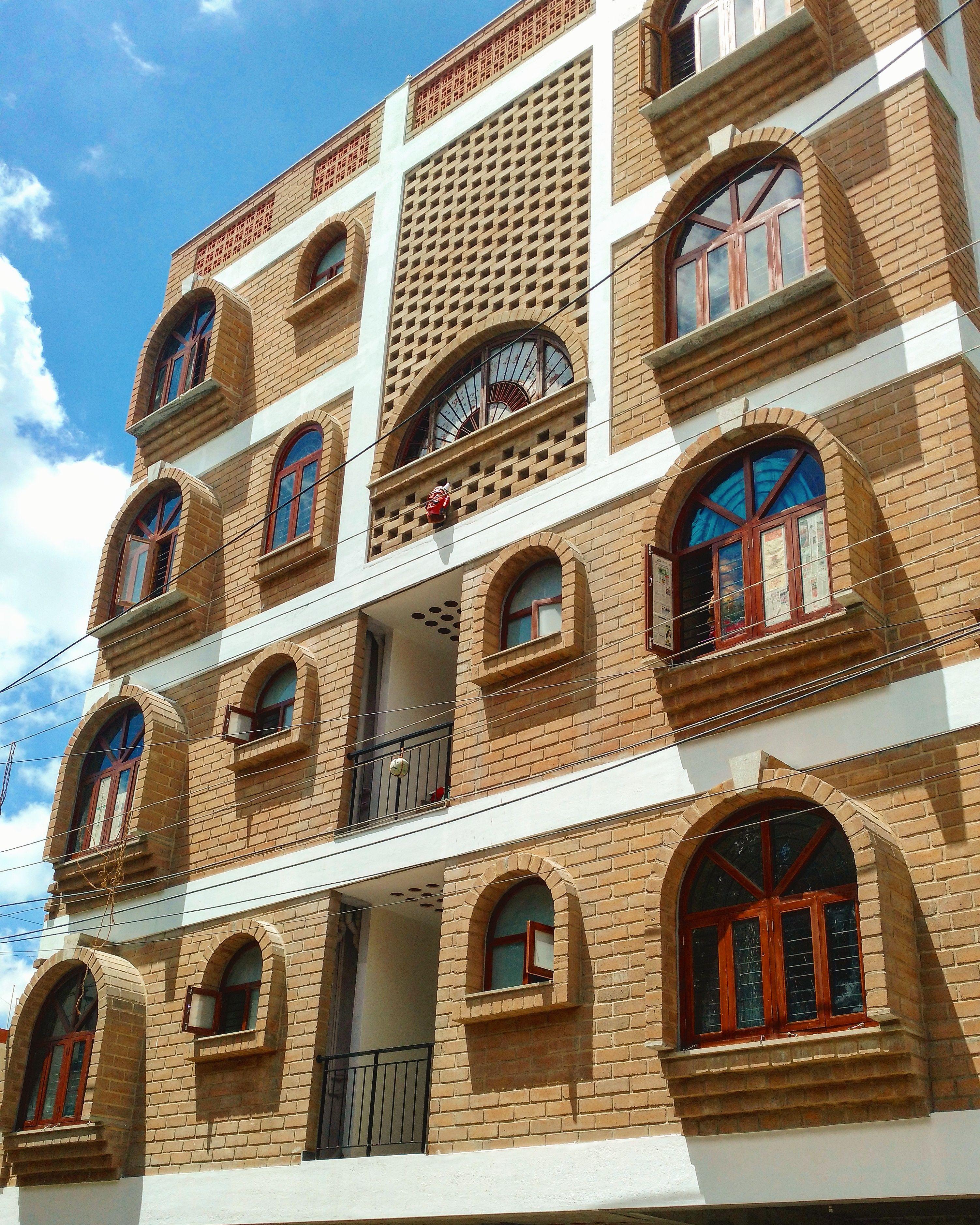 Vernacular Jali Wall Resident Brick Arch Courtyard House Design