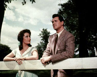 GIANT (1955) - Texas rancher Bick Benedict (Rock Hudson)  Virginia socialite Leslie Lynnton (Elizabeth Taylor) - Based on the novel by Edna Ferber - Produced  Directed by George Stevens - Warner Bros. - Movie Still.
