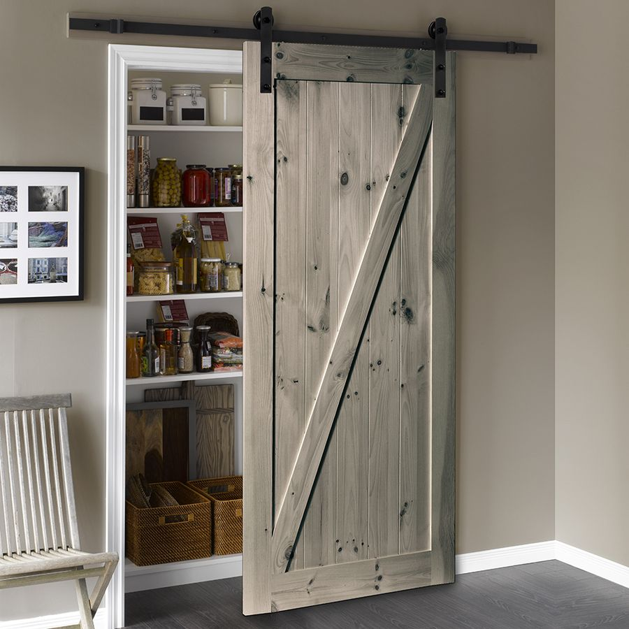 Get a modern farmhouse look and conserve space with a - Exterior sliding barn door hardware lowes ...