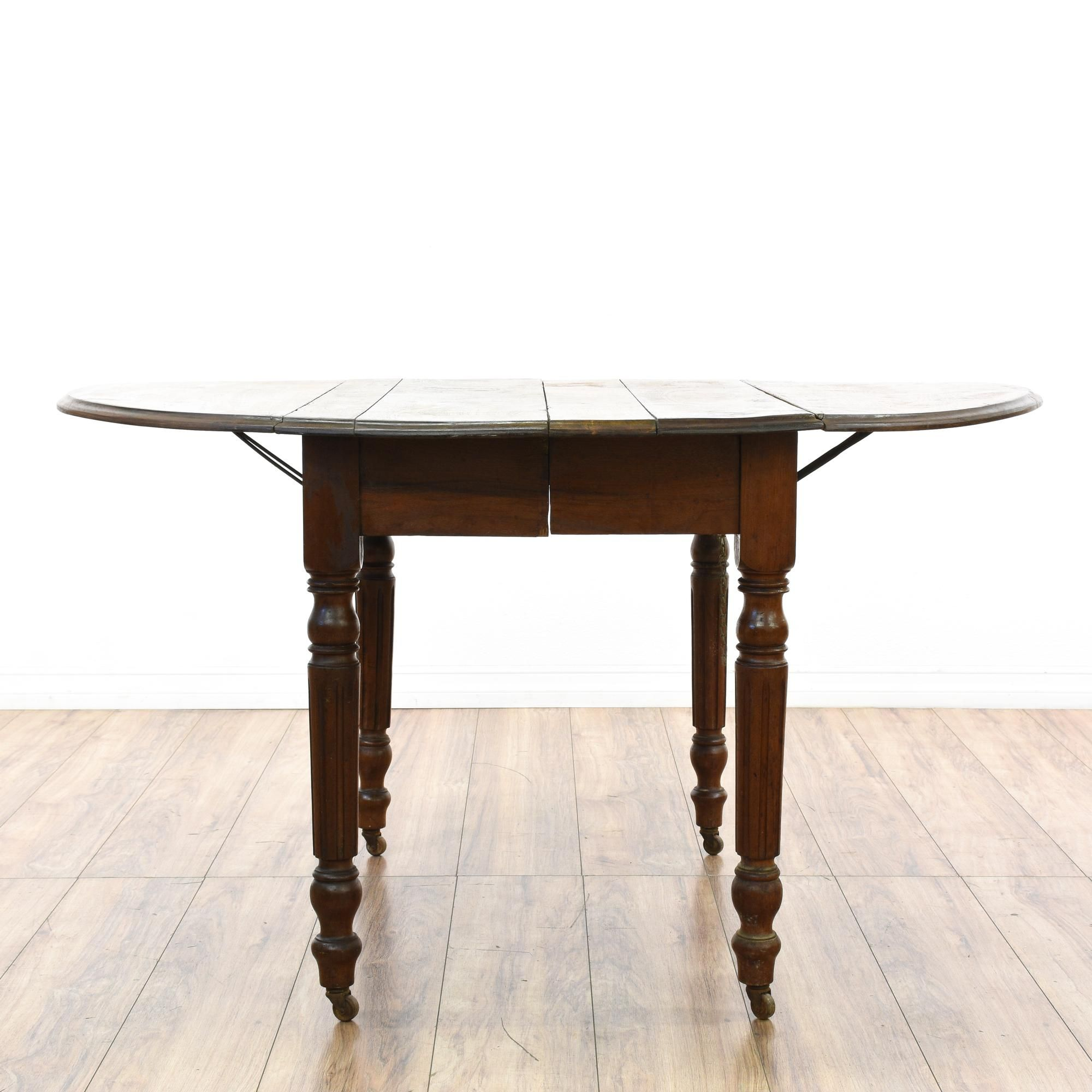 This Country Chic Style Kitchen Table Has Carved Fluted Legs,