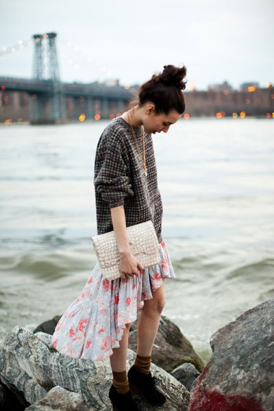 I love sweaters and floral, flowing skirts for spring ;) And check out that glamorous clutch!