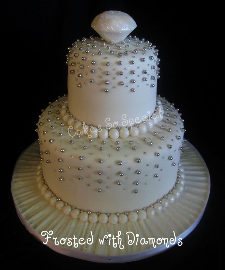 """For a local jewelry store's 65th anniversary.  This is actually the back of the cake...the front has two """"sapphires""""."""