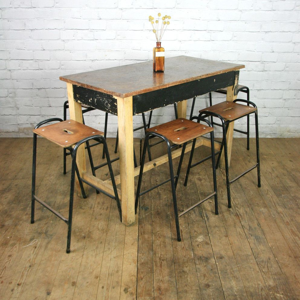 A pair of reclaimed school laboratory stacking stools