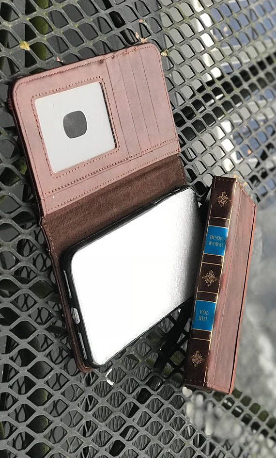 LIKE US ON FACEBOOK! Hi from jtbcompany! We are a small shop based in Madisonville Kentucky. We have an extensive track record on eBay but are just now reaching out to Etsy. What your looking at; Quality Leather Book style wallet case for the iPhone. Rubber case that fits the