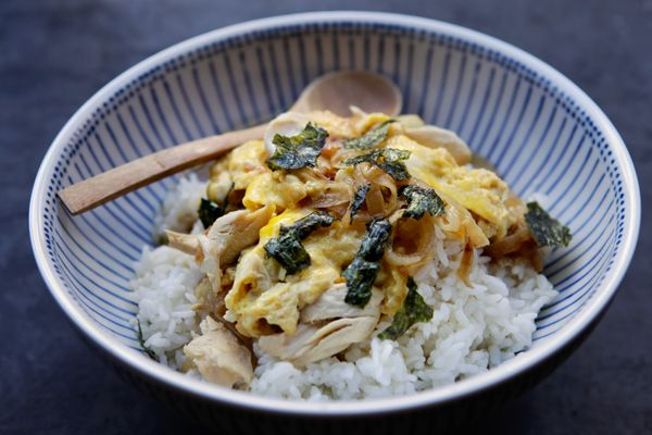 Bravetart's slightly Americanized version of oyakodon, chicken (or turkey) and egg poached in broth, served over caramelized onions and steamed rice. Mmmmm, comfort food.   - :: -   bravetart.com/recipes/Oyakodon