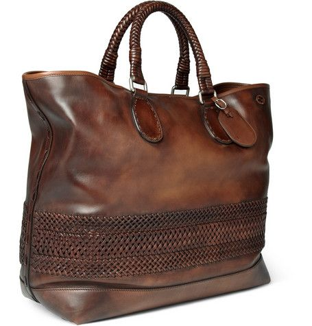 """795a8b1c5b88 A proper leather men's hold-all from the Gucci line. What makes this one  yours, is its got JUNA all over it. """"Discreet double 'G' insignia and a  panel of ..."""
