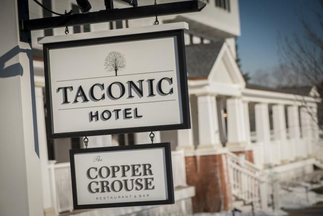 Taconic Hotel and The Copper Grouse Restaurant signs in front of the hotel in Manchester, Vermont. - Paul Gelsobello