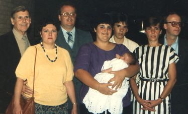 Dad, (his wife) Sue, Ed, Me, Jeff, Gail, John, and Brad - Brad's Baptism at St. Veronica's Church 1987