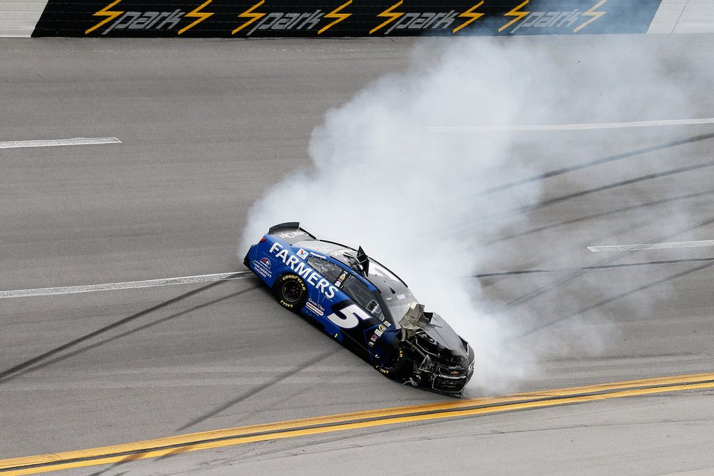 Kasey Kahne Photos - Kasey Kahne, driver of the #5 Farmers Insurance Chevrolet, has an on track incident during the NASCAR Sprint Cup Series GEICO 500 at Talladega Superspeedway on May 1, 2016 in Talladega, Alabama. - NASCAR Sprint Cup Series GEICO 500