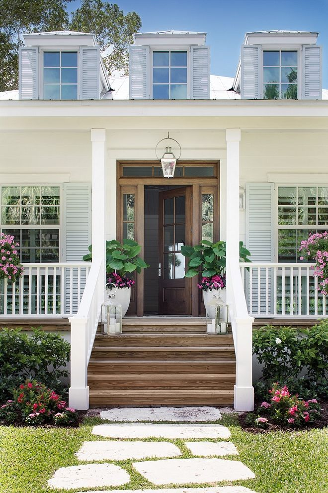 Curb Appeal Home Exterior Large wraparound porches, metal roof, lap siding, louvered and Bahamas shutters adds to the curb-appeal of this beach house #CurbAppeal #HomeExterior #wraparoundporch #Beach #Cottage #Florida