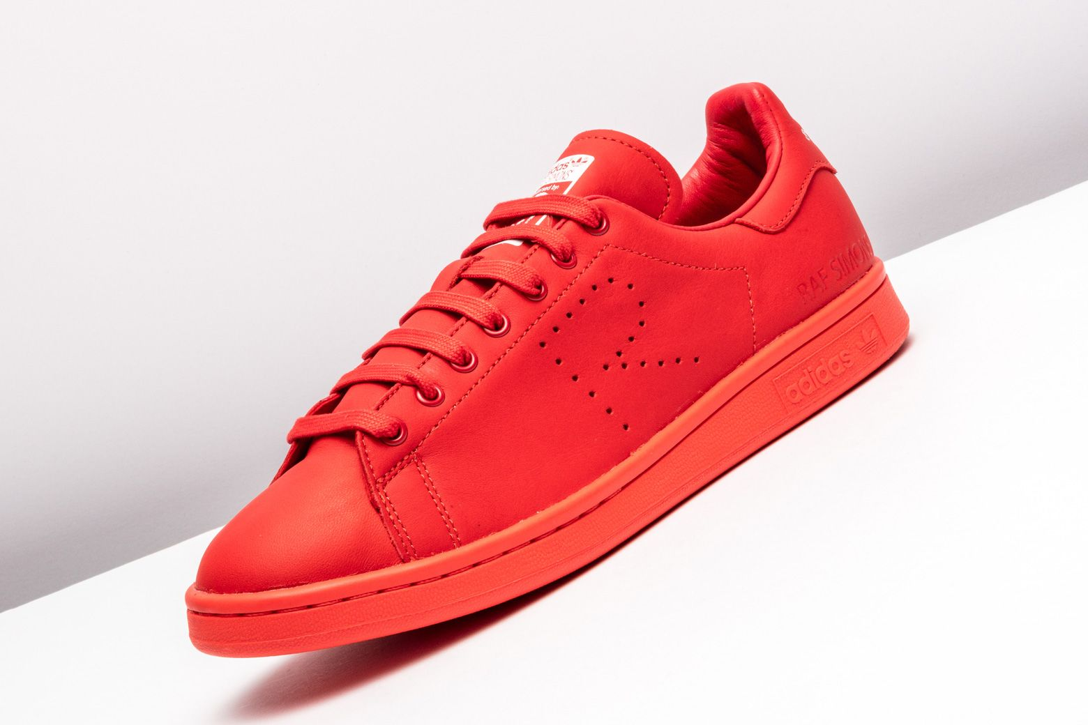 758faa4bc3d5 The Raf Simons edition adidas Stan Smith receives a head-turning tonal red  colorway.
