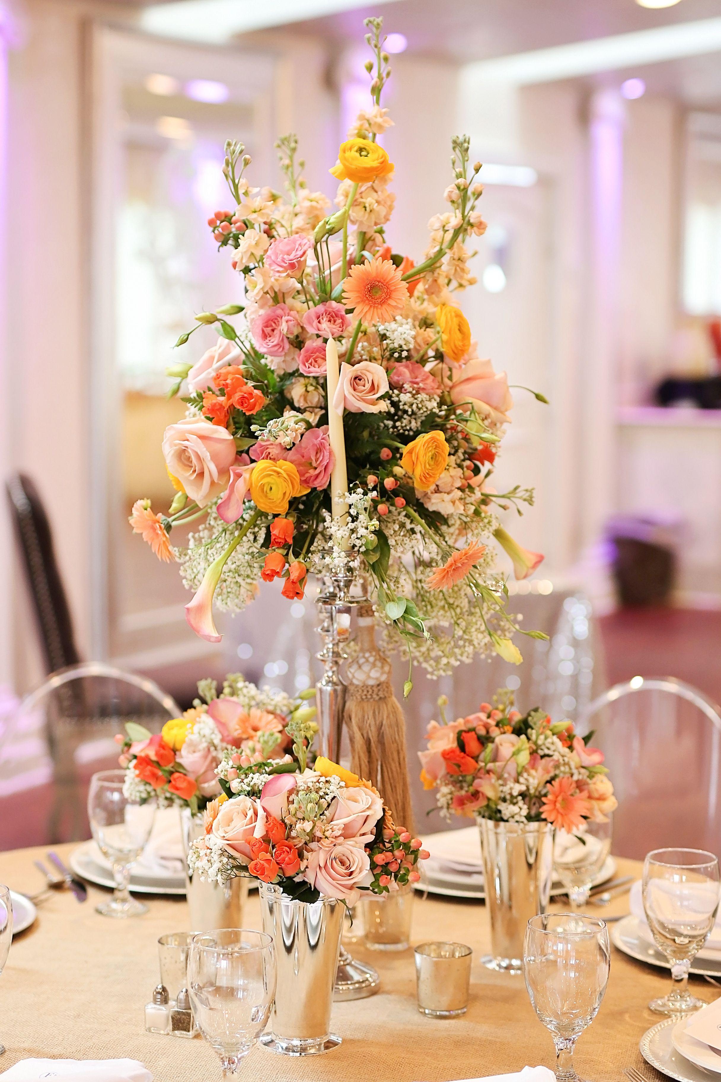 Tall wedding reception floral centerpiece with peach gerbera daisies, … |  Orange wedding centerpieces, Wedding flower centerpieces tall, Flower  centerpieces wedding