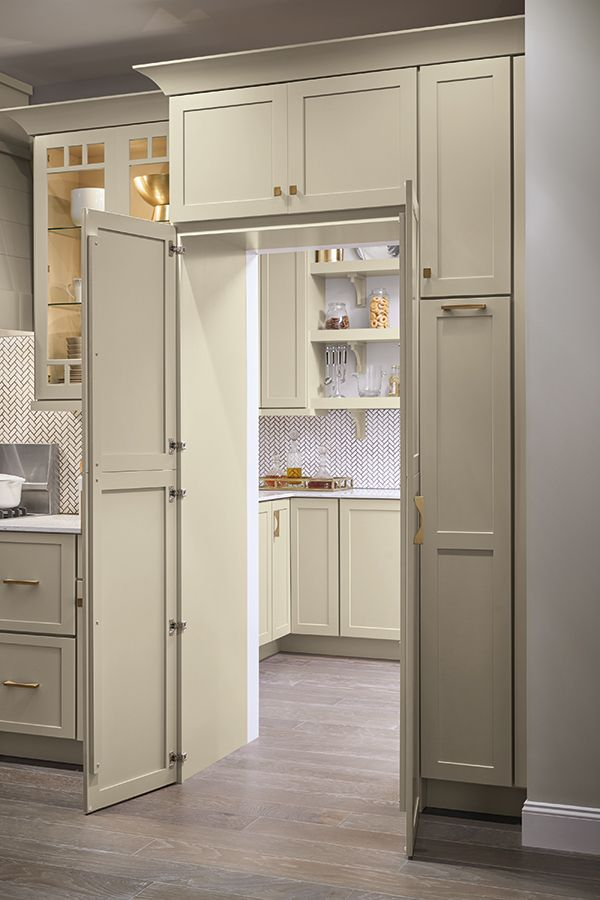 Is a walk-in pantry at the top of your kitchen remodel wish list?  The Pantry Walk Through Cabinet allows you to maintain design cohesion with full-height cabinet doors that serve as a doorway to a second space. #pantrycabinet