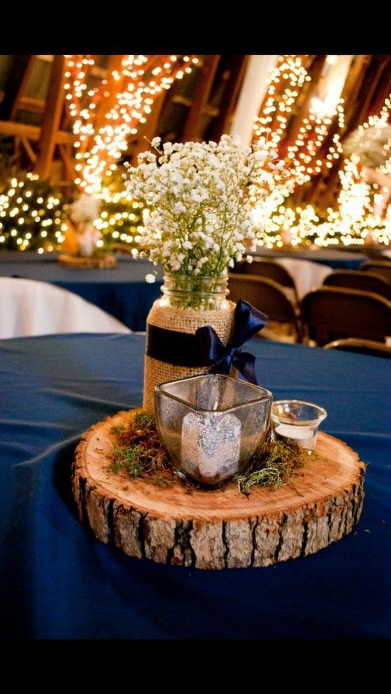 Navy Blue Mason Jars Filled With Baby S Breath Votives And Moss On Wood Slices For A D Blue Wedding Centerpieces Rustic Wedding Centerpieces Wedding Table