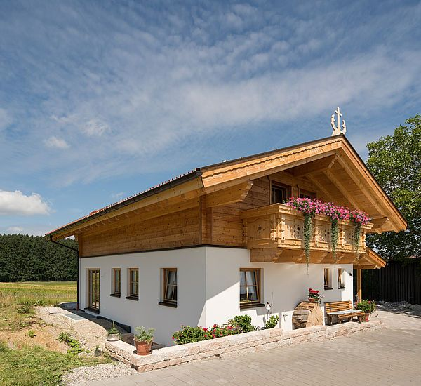 Tiroler Kombihaus / RiegelBlockHauskombination bauen in
