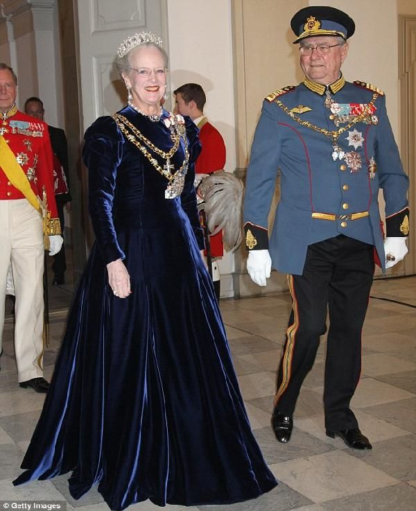 Queen Margarethe II of Denmark in a dark blue or black velvet gown which seems a popular royal choice going by 2 other nearby pins...quite the coincidence.